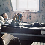[A faded picture of the young Philippe Coupey, reading in bed at La Gendronnière Zen Temple, 1980]